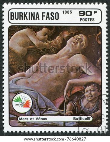"BURKINA FASO - CIRCA 1985: A stamp printed in the Burkina Faso, is devoted to the International Philatelic Exhibition Italia 85, shows a picture of Botticelli, ""Venus and Mars"", circa 1985 - stock photo"