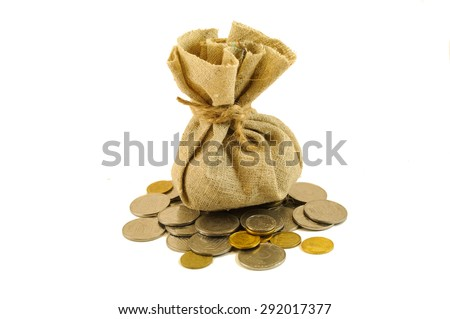 burlap bag with coins isolated on white background - stock photo