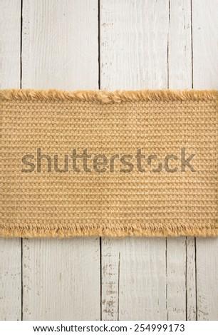 burlap hessian sack on wooden background - stock photo