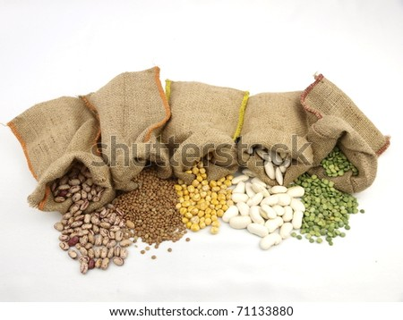 Burlap sacks with a misc legumes - stock photo