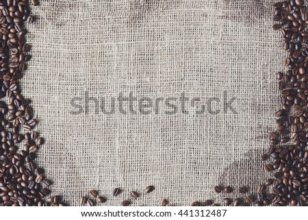 Burlap texture with coffee beans border. Sack cloth background. Brown natural sackcloth canvas with frame and copy space. Seeds at hessian textile - stock photo