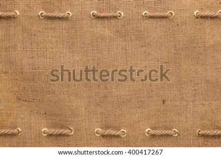 Burlap with two lines of rope - stock photo