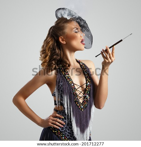 Burlesque. Cute, beautiful woman with cigarette - stock photo