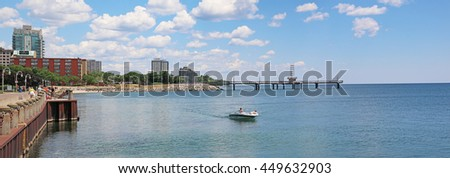 BURLINGTON, CANADA - JULY 8, 2016: Speedboat in a view of Lake Ontario from the Waterfront Trail, Spencer Smith Park, Burlington, Ontario, Canada - stock photo