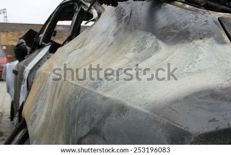 Burn sport car - left rear side - stock photo