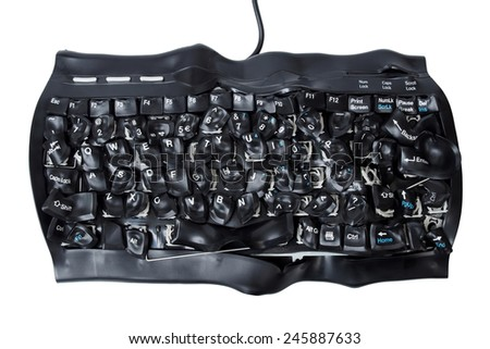 Burned and broken computer keyboard isolated on white background - stock photo