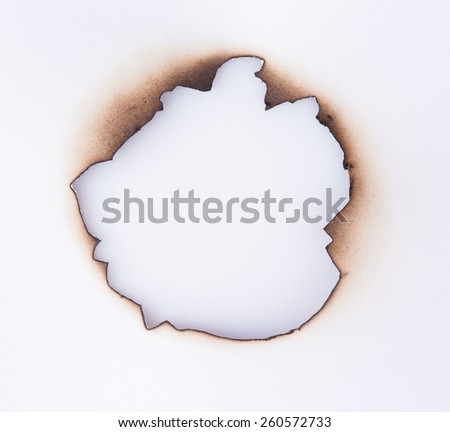 Burned hole on a white background - stock photo