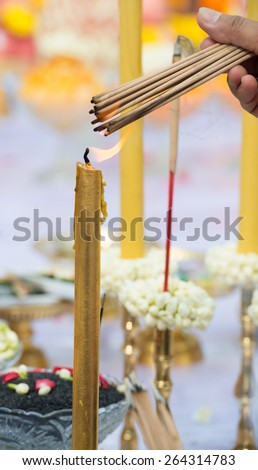 burned incense offering worship in ritual - stock photo