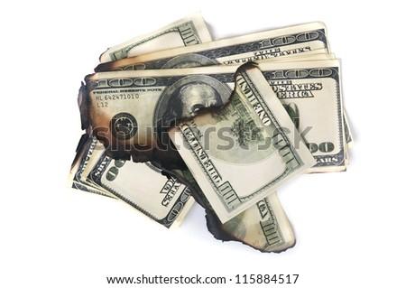 burned pack of dollars isolated on white background - stock photo
