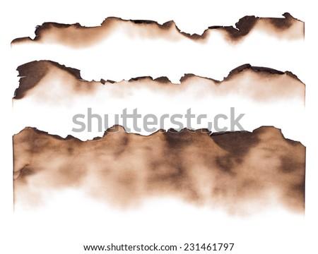 Burned paper edges isolated on white background - stock photo
