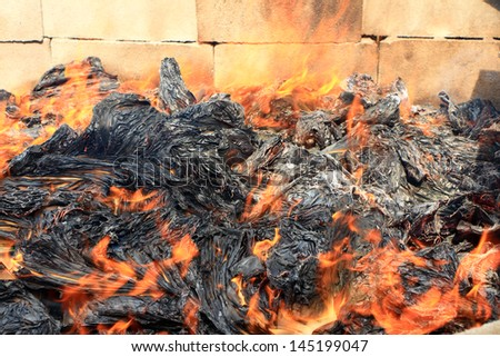 Burned paper with fire - stock photo