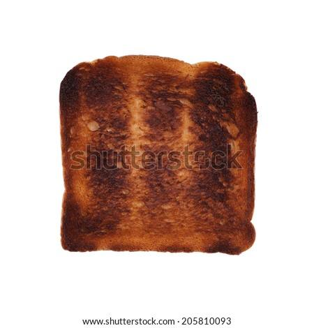 burned toast isolated on white - stock photo