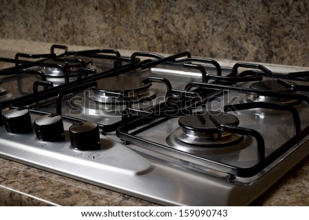 burners on the gas stove in the kitchen - stock photo