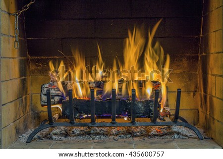 Burning and glowing pieces of wood in Fireplace. Fire in fireplace. Closeup of firewood burning in fire. Fireplace in the house.  - stock photo