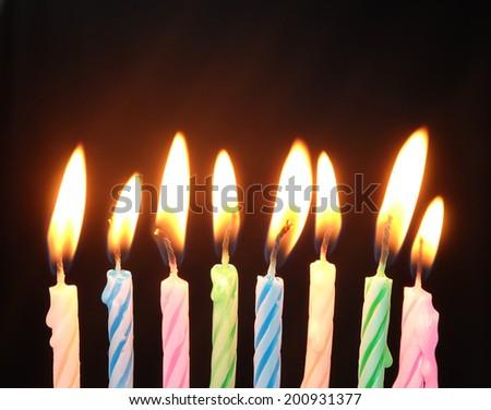 burning  birthday candles  - stock photo