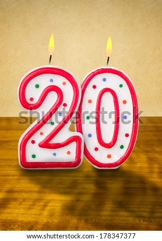 Burning birthday candles number 20 - stock photo