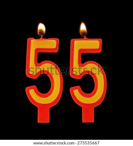 Burning birthday candles on black, number 55 - stock photo