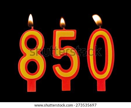 Burning birthday candles on black, number 850 - stock photo