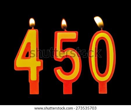 Burning birthday candles on black, number 450 - stock photo