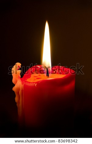 Burning candle - stock photo