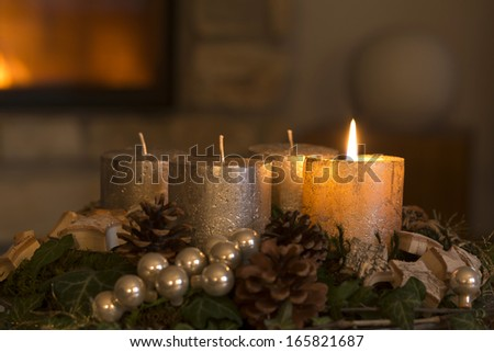 Burning candle on an advent wreath - stock photo