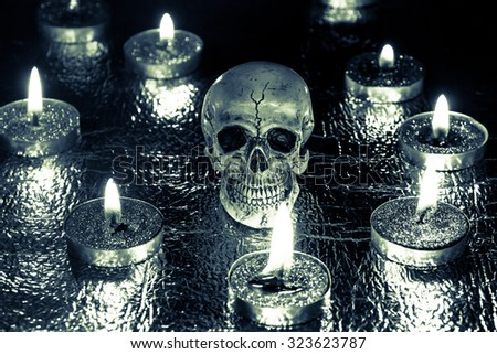 Burning candles and skull sepia cold tone ,Halloween - stock photo