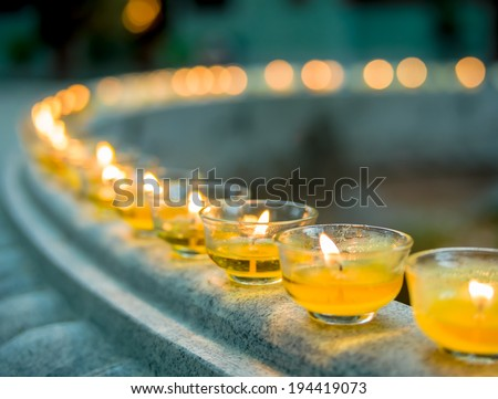 Burning candles at a Buddhist temple - stock photo