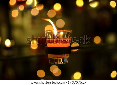 burning candles bokeh blured background. - stock photo