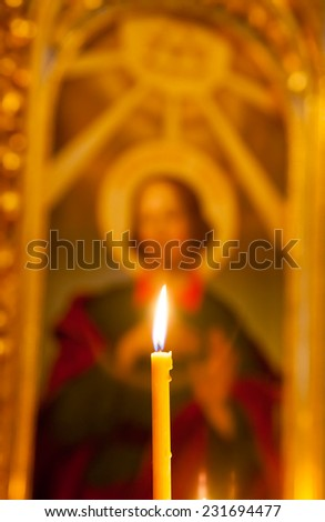 Burning candles in church - stock photo