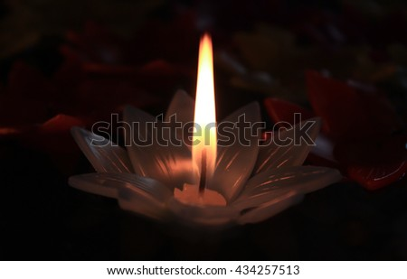 Burning candles lighting the darkness, Selective focus. - stock photo