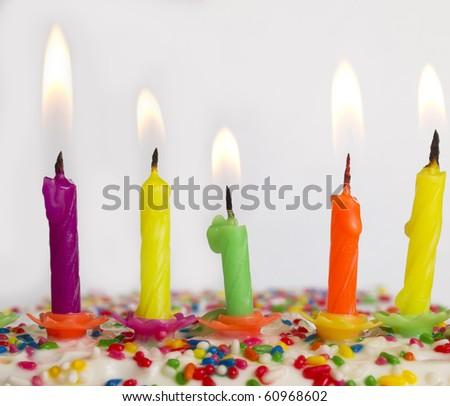 burning candles on the cake - stock photo