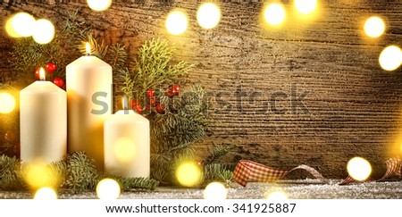 Burning candles with decorations on wood background - stock photo