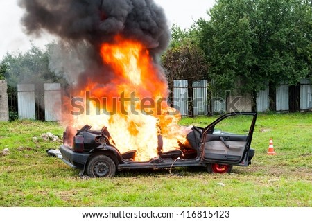 Burning car. Fire suddenly started engulfing all the car - stock photo