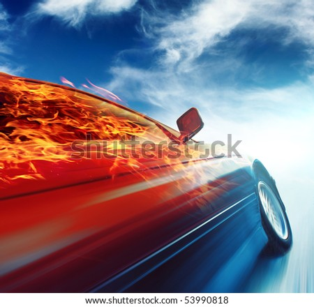 Burning car in motion over blue sky background - stock photo