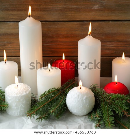 burning christmas candles and spruce, holiday - stock photo