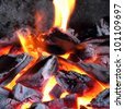 Burning coals - stock photo