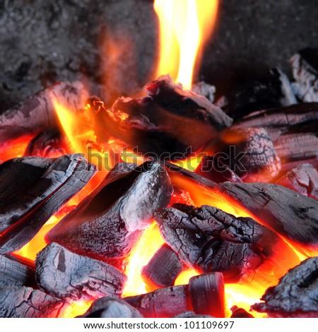 Burning coals - stock photo