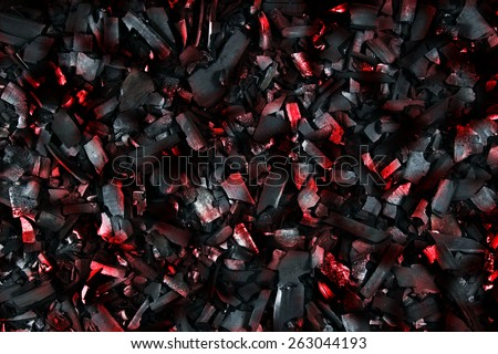 Burning coals. Decaying charcoal. Backround with charcoal. - stock photo