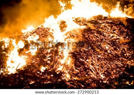 burning debris on a huge bonfire - stock photo
