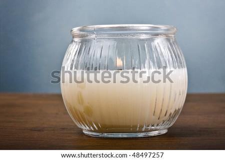 Burning decorative scented candle closeup - stock photo