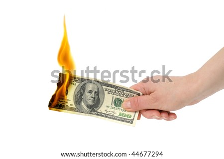 burning dollar in hand isolated on a white - stock photo