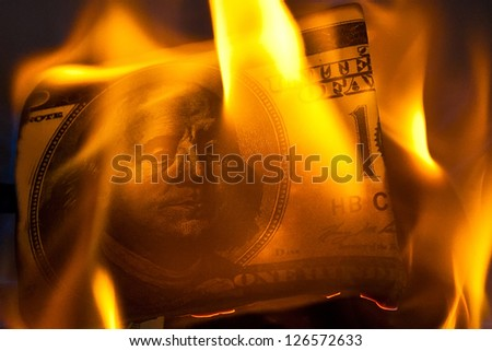 Burning dollars - stock photo