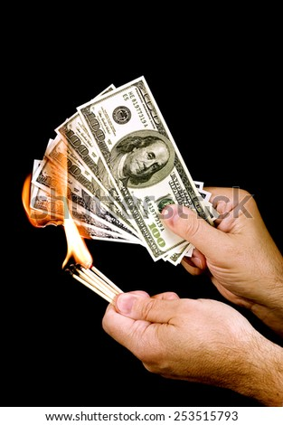 Burning Fake Money/ One Way Of Losing Money - stock photo