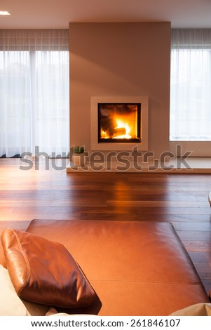 Burning fireplace in cozy living room interior - stock photo