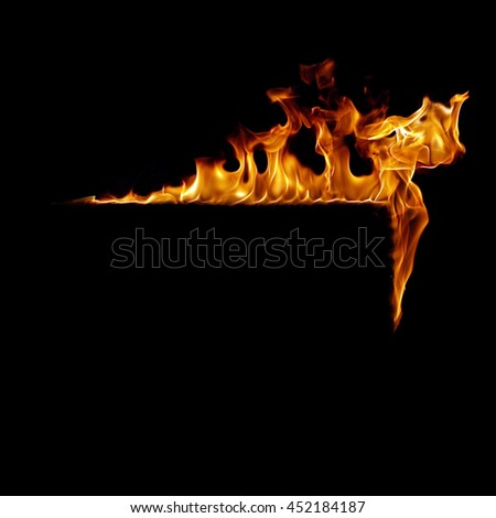 Burning flame or fire frame isolated on black background - stock photo