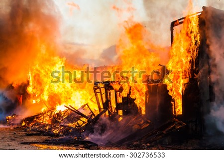 Burning house - stock photo