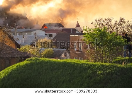 burning house, roof lights, flame lights - stock photo