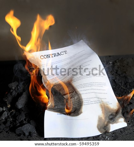 Burning in the flames of the fire contract - stock photo
