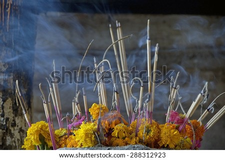 burning incense  in Pac Ou Caves Laos - stock photo
