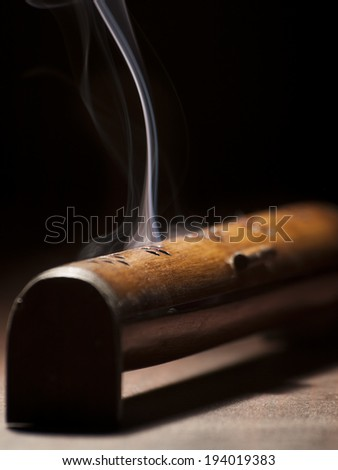 burning incense stick in the box, for religious, spiritual,healing themes - stock photo